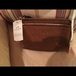 Coach Tan dual zipper leather wristlet